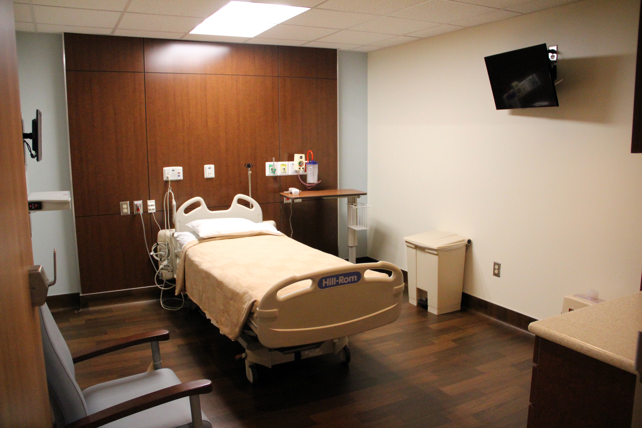 Room with an empty, neat hospital bed