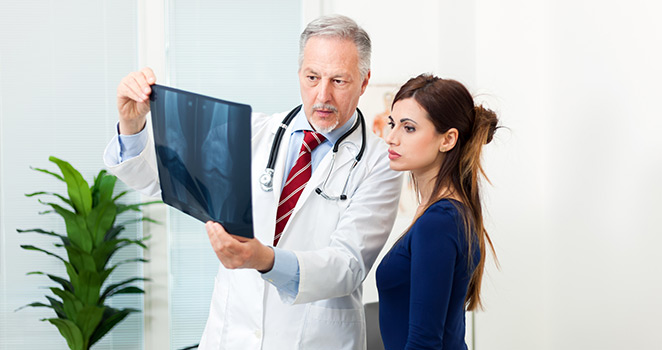 Doctor shows a woman some X-ray results