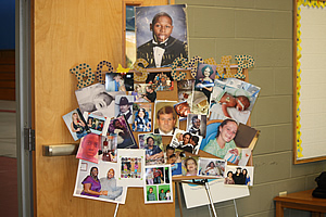 Collage of images of children who have attended the camp in the past on a door.