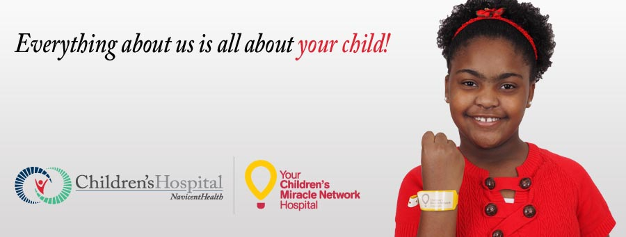 "Young girl with a hospital ID bracelet smiling. Message on the image reads, ""Everything about us is about your child."""