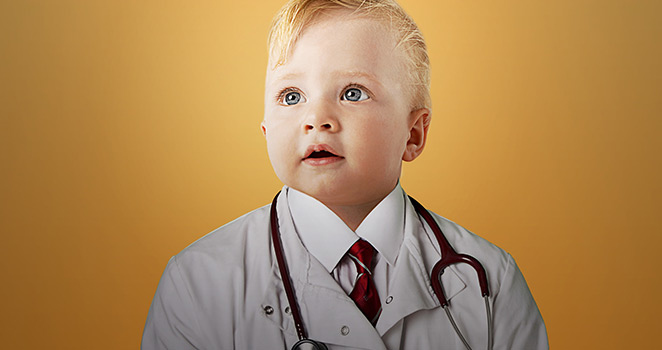 Baby in a doctors coat