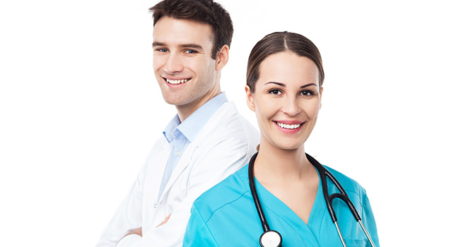 Doctor and nurse standing together smiling