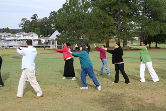 Residents learn some stretching techniques in an outside class
