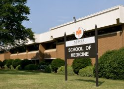 Front of the Mercer School of Medicine building and sign