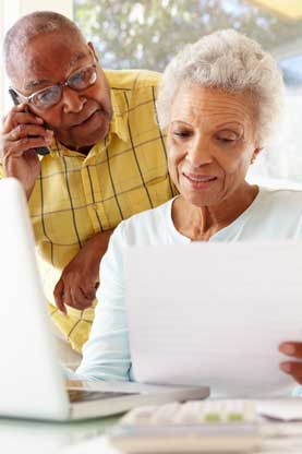Elderly couple looking over information